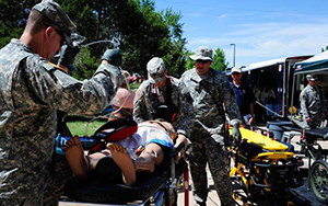 Medics work on dummies during a mass casualty exercise