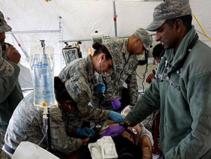 A mass casualty exercise features medics working on