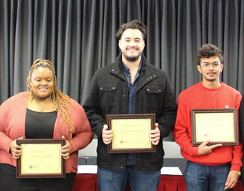 Autumn Conner, Cristian Rosales, and Angel Lozano hold up their MLK scholarships