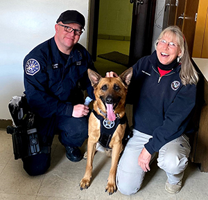Denver Sheriff Deputy Sheriff K-9 Handler John Curry, Kuko, and DMI Director Pony Anderson sit for a photo during a training session on March 25.