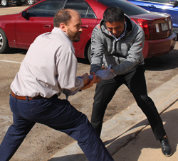 Chris Tombari, Dean of the School of Liberal Arts, and Victor Vialpando, Dean of the School of Professional Studies and Sciences, try to pull apart a frozen T-shirt