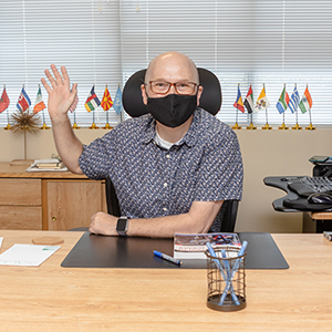 Dean of Academic Affairs and Concurrent Enrollment Bobby Pace waves from his desk