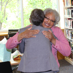CCA President Betsy Oudenhoven hugs Sheryl Broadnax, Administrative Assistant in the Office of Disability and Equity at Sheryl's retirement party