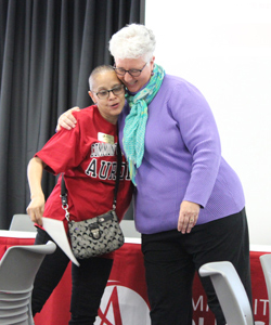 Paulette Dalpes hugs Denise Lewis during the Student Employee appreciation event.