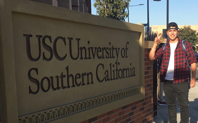 Ulises Venegas-Rivera in front of a University of Southern California sign