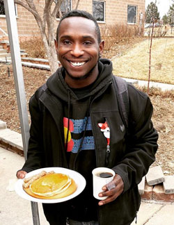 Walter James shows off his pancakes and coffee on the first day of classes of the spring 2020 semester